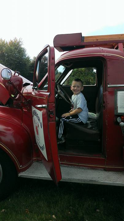Child in Antique Firetruck