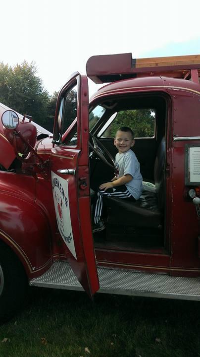 Child in Antique Firetruck